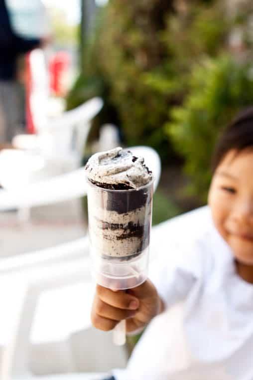Kid holding a Push Up Cupcake.