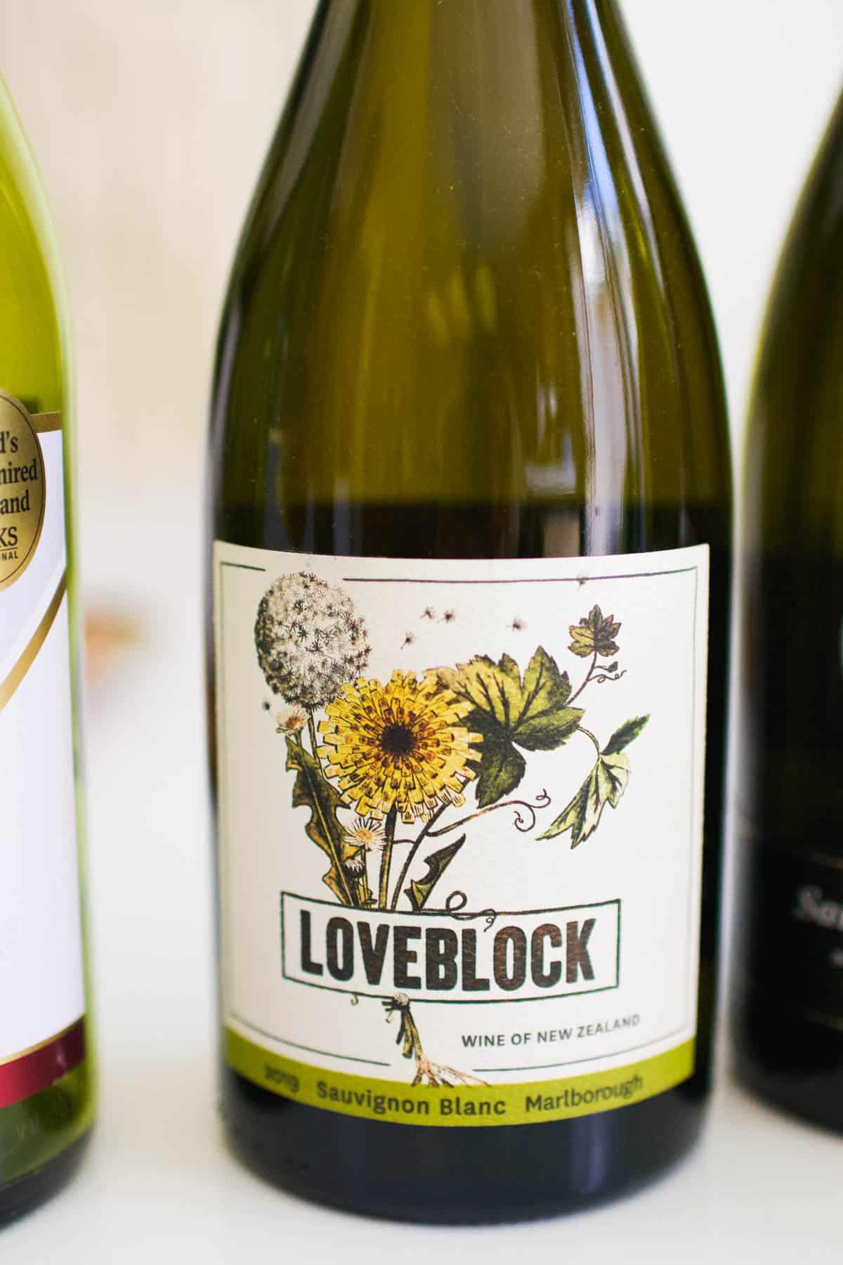 Close up of a Loveblock Sauvignon Blanc bottle.